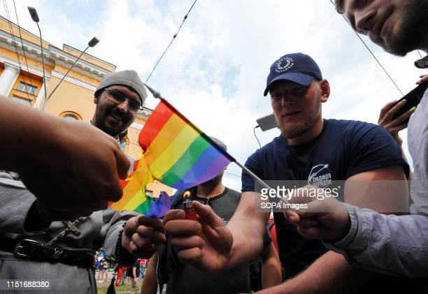 Ukrainian ultra nationalist activists burn an LGBT flag during protest against the annual Gay Pride parade in Kiev More than 8000 people turned out...