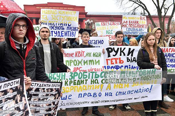 Ukrainian university students hold placards reading 'We demand scholarship indexing' 'Hands off of student unions' 'We demand quality education' and...