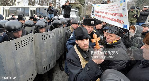 Ukrainian veterans and invalids of Chernobyl's nuclear disaster clash with riot policemen standing guard in front of the parliament's building in...
