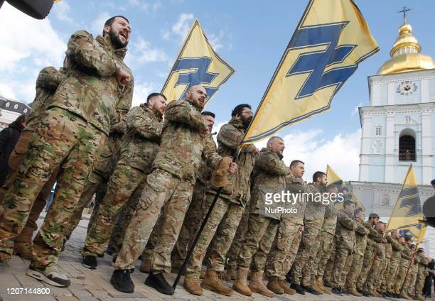 Ukrainian veterans of the 'Azov' volunteer battalion attend a rally dedicated to the Volunteer Day in honor of volonteer fighters who joined...