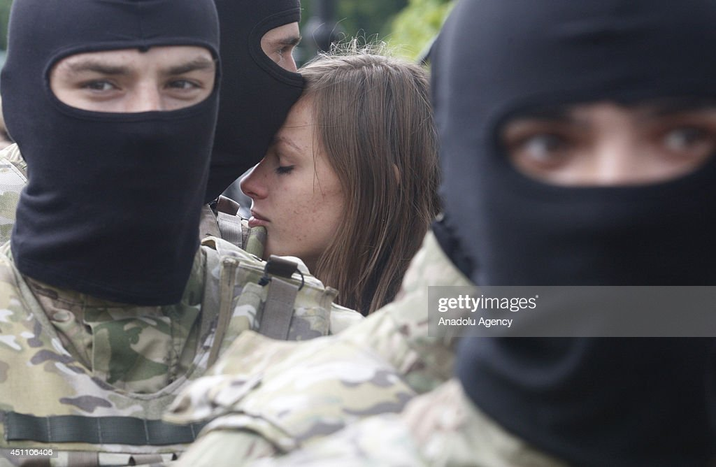 A Ukrainian volunteer recruit of battalion 'Azov' bid farewell by his girlfriend after an oath of allegiance ceremony near the monument to Bogdan Khmelnitsky in the center of Kiev, Ukraine on June 23, 2014.