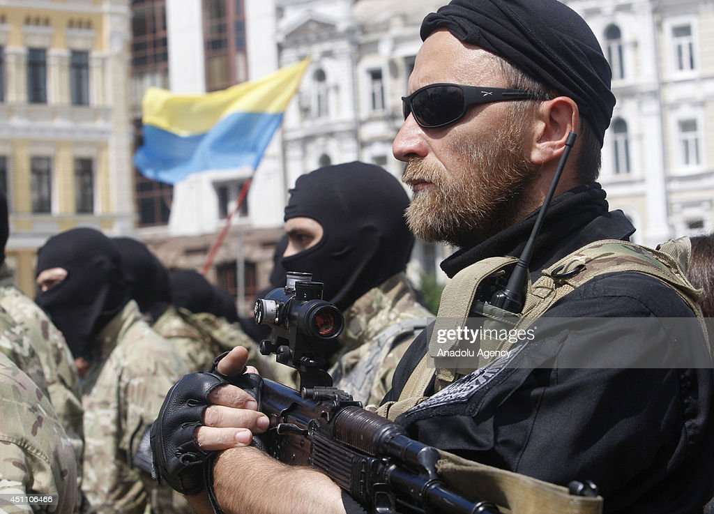 Ukrainian volunteer recruits of battalion 'Azov' attend an oath of allegiance ceremony near the monument to Bogdan Khmelnitsky in the center of Kiev, Ukraine on June 23, 2014.