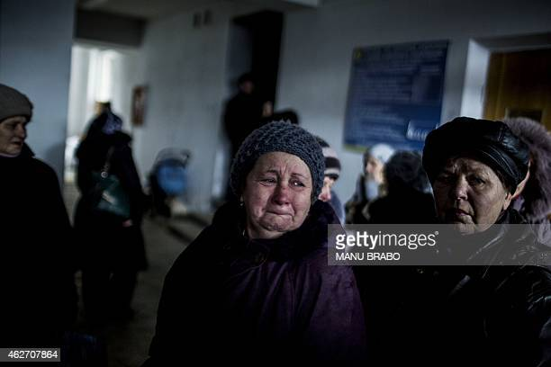 Ukrainian woman cries in an administration building before taking a bus to flee her town in Debaltseve, in the Donetsk region, on February 3, 2015....