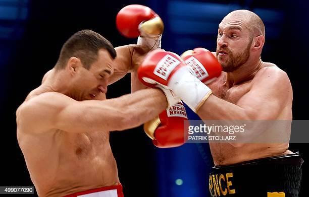 Ukrainian World heavyweight boxing champion Wladimir Klitschko and Britain's Tyson Fury compete during their WBA IBF WBO and IBO title fight in...