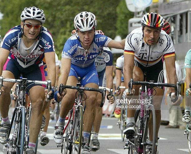 Ukrainian Yuri Krivtsov Italian Luca Paolini and German Erik Zabel cross the finish line at the end of the 16th stage of the 90th Tour de France...