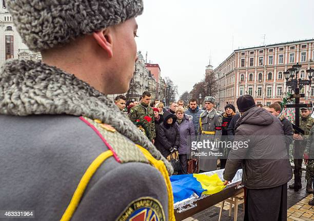 Ukrainians attend the funeral ceremony for a serviceman of Holy Mary battalion Cyril Heinz also known as German at Sophia Square He was 29 years old...
