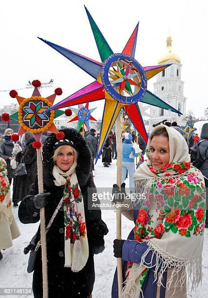 Ukrainians dressed in traditional ethnic costumes sing Christmas carols as they attend Procession of Didukh during Orthodox Christmas celebration in...