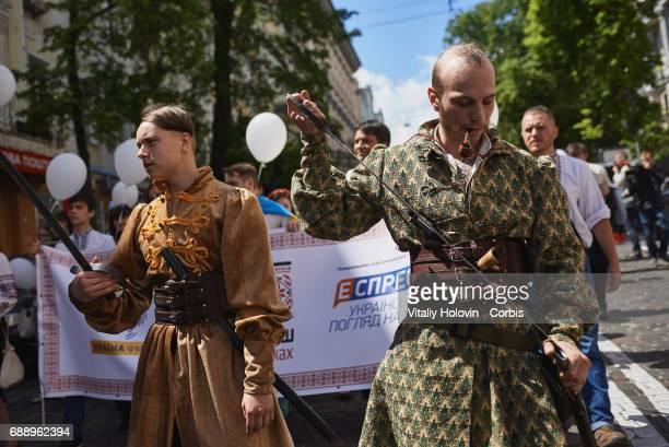 Ukrainians dressed in vyshyvankas with traditional embroideries attend the 'March in vyshyvankas' in downtown on May 28 2017 in Kiev Ukraine