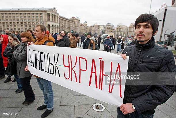 Ukrainians from the East hold in their hands a placard reading quotDonbass is Ukrainequotduring a rally called quotIn the name of the memory of the...