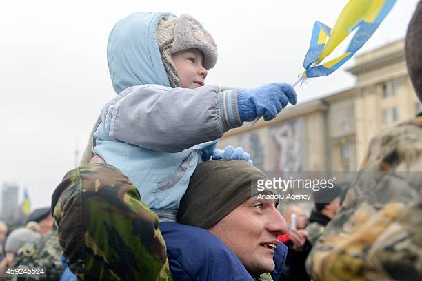 Ukrainians gather at Independent Square to welcome Ukrainian army soldiers who clash with proRussian separatists in the eastern of the country in...