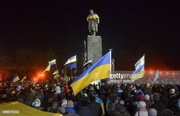 Ukrainians gather for a rally in the northeastern Ukrainian city of Kharkiv at the Taras Shevchenko monument on November 21 2014 to mark the first...