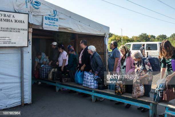 Ukrainians have their bags checked at a Ukraine Army controlled checkpoint between Ukrainian government and proRussian separatist governed territory...
