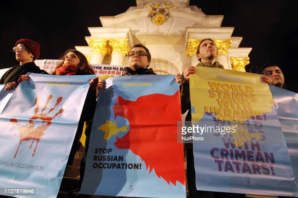 Ukrainians hold placards and portraits of the detainees and the missing Crimean Tatars and proUkrainian activists in the Crimea during a rally on the...