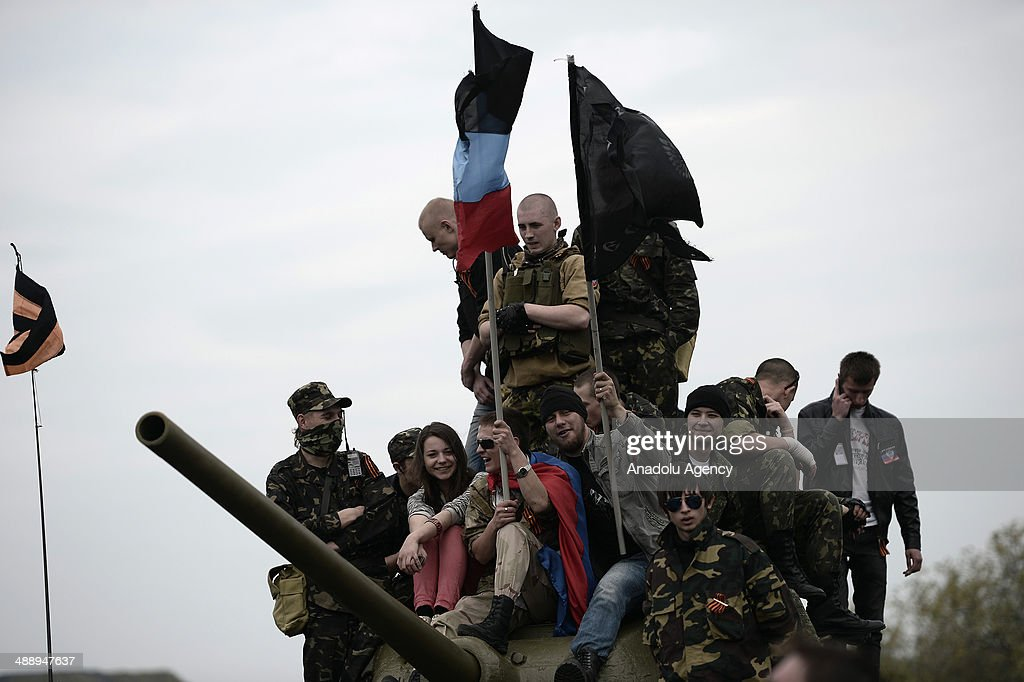 Ukrainians in Donestsk gather around the To Donbass Liberators, a monument in Lenin Comsomol park, Donetsk, dedicated to the memory of all military units and formations that liberated Donbas during the World War II, for 9 May Victory Day celebrations, Ukraine, 2014.