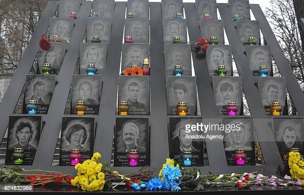 Ukrainians lay flowers and light candles at the memorial to victims of Maidan protests during a memorial ceremony devoted third anniversary of the...