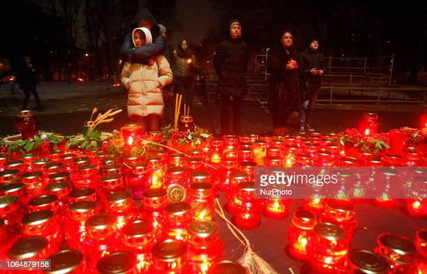 Ukrainians light candles in the memory of victims of Great Famine in Ukraine of 19321933 at a monument to victims of the Holodomor in Kiev Ukraine 24...