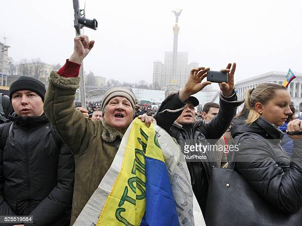 Ukrainians take a part a rally to mark the second anniversary of the Euromaidan Revolution at the Independence Square in Kiev Ukraine 22 November...