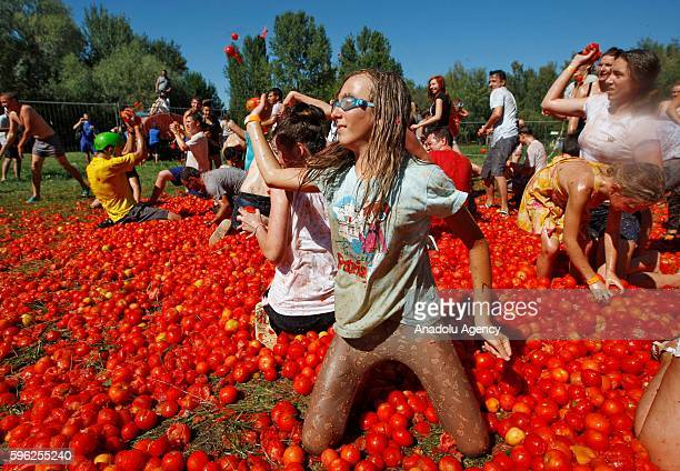 Ukrainians take part in the tomato fight during Tomatina festival in Kiev Ukraine on August 27 2016 Festival inspired by Spanish 'La Tomatina...