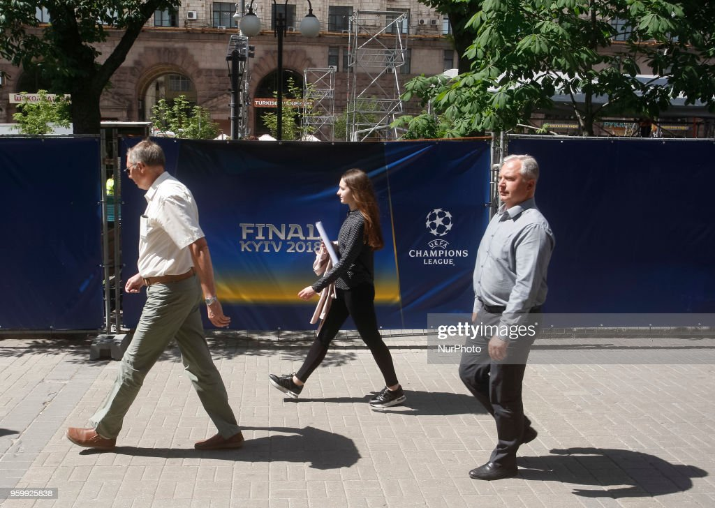 Ukrainians walk past a fence of a fan zone of the UEFA Champions League final in central Kiev, Ukraine, 18 May, 2018. The football UEFA Champions League final match between Real Madrid and Liverpool FC next May 26 at the NSC Olimpiyskiy Stadium.