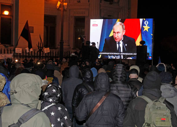 UKR: Ukrainians Watch A Press Conference Of Normandy Four Leaders