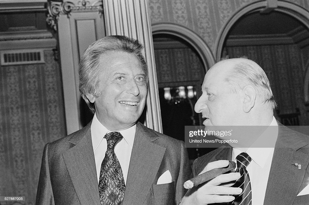 Ukranian born British Impresario brothers, Bernard Delfont (1909-1994) on left and Lew Grade (1906-1998) on right, pictured together in London on 1st September 1977.