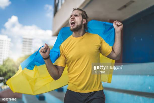 ukranian fan watching a soccer game - ukraine stock pictures, royalty-free photos & images