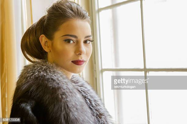 ukranian female model posing front of window at lviv ukraine - up do stock pictures, royalty-free photos & images