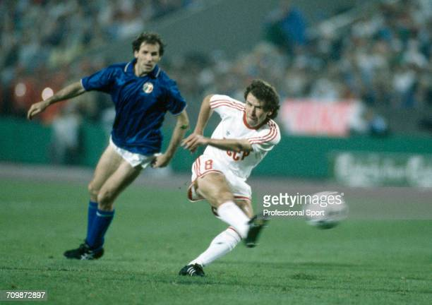 Ukranian footballer Hennadiy Lytovchenko shoots for goal during play for the Soviet Union team to beat Italy 20 in the semi finals of the UEFA Euro...
