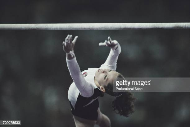 Ukranian gymnast Tatiana Gutsu competes for the Unified team on the uneven bars to finish in first place to win the gold medal in the Women's...