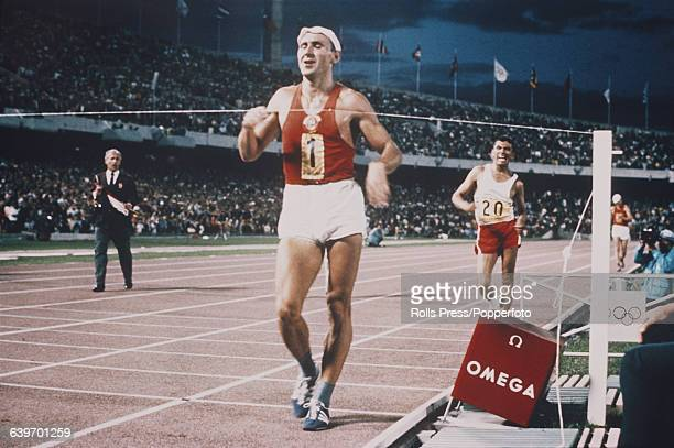 Ukranian racewalker Volodymyr Holubnychy, competing for the Soviet Union, crosses the finish line in first place to win the gold medal in the Men's...