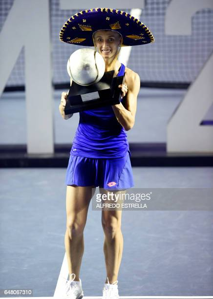 Ukranian tennis player Lesia Tsurenko poses with the trophy after winning the Mexican Tennis Open WTA final match against French Kristina Mladenovic...