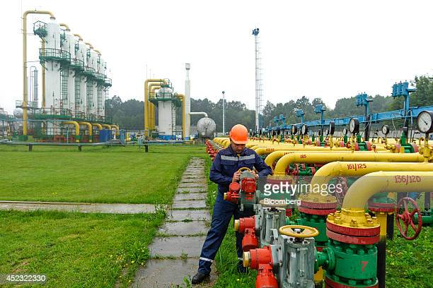 A UkrTransGaz employee adjusts a control wheel on pipework at the Dashava underground gas storage facility operated by UkrTransGaz a unit of NAK...