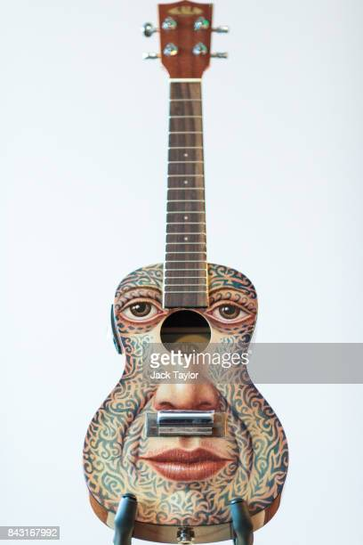 A ukulele painted by artist George Underwood is pictured at Shoreditch House ahead of it being featured in the Art on a Ukulele fundraiser concert on...
