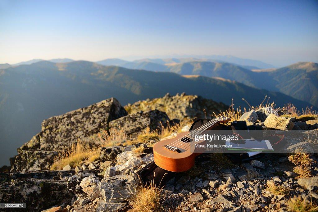 Ukulele resting on a mountain summit : Stock Photo
