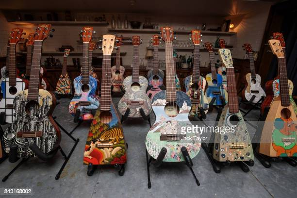 Ukuleles painted by various artists on display at Shoreditch House ahead of them being featured in the Art on a Ukulele fundraiser concert on...