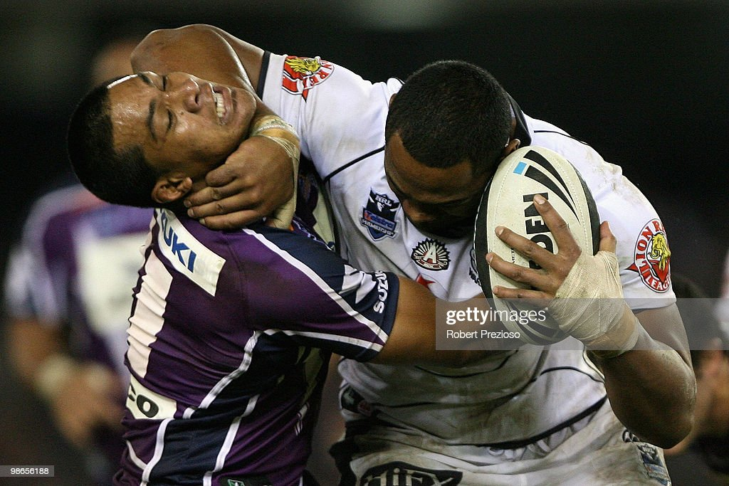 Ukuma Ta'ai of the Warriors is tackled by Willie Isa of the Storm during the round seven NRL match between the Melbourne Storm and the Warriors at Etihad Stadium on April 25, 2010 in Melbourne, Australia.