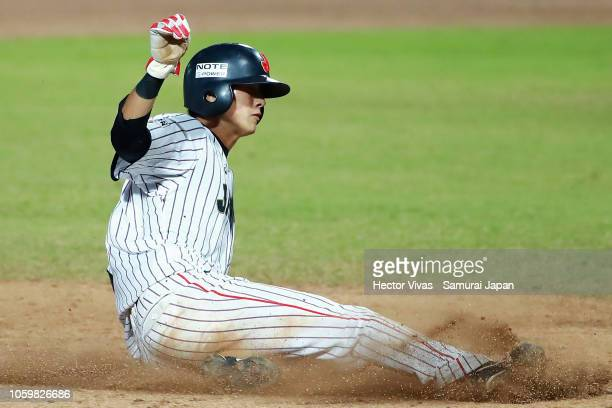 Ukyo Shuto of Japan slides safely into third base in the 8th inning during the WBSC U23 World Cup Super Round between Japan and Venezuela at Edgar...