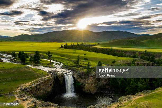 ulaan tsutgalan, orkhon waterfall in mongolia at sunset. aerial view - valley stock pictures, royalty-free photos & images