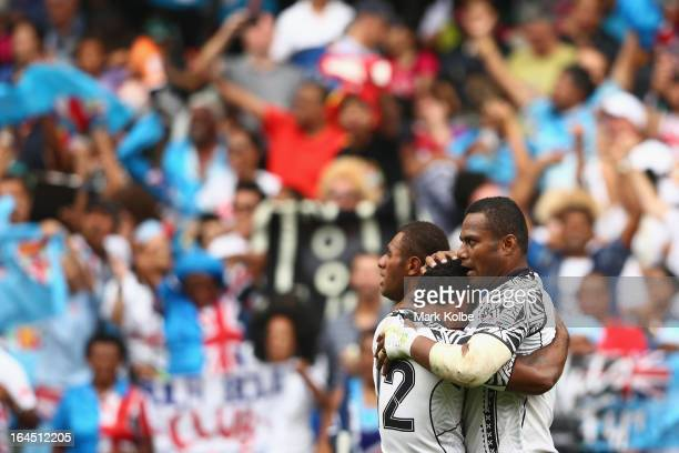 Ulaiyasi Lawavou of Fiji celebrates with his team mates after scoring a try during the cup semi final match between New Zealand and Fiji during day...