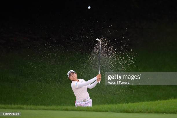 Ulala Onuki of Japan hits out from a bunker on the 16th hole during the first round of the Earth Mondamin Cup at the Camellia Hills Country Club on...