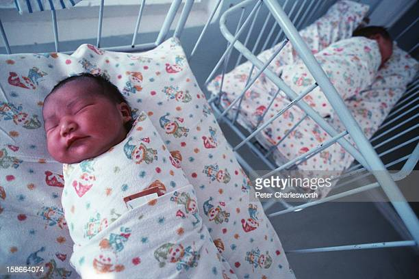 Ulan Bator ULAN BATOR Mongolia Newborn babies lying in cots are tightly wrapped in traditional style in the maternity ward of a state run hospital in...
