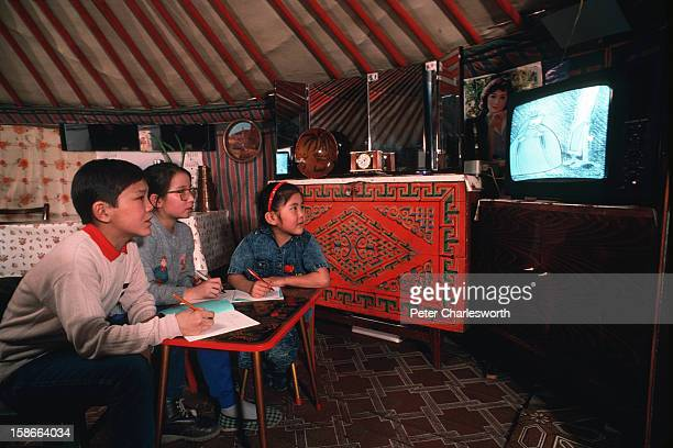 Ulan Bator ULAN BATOR Mongolia Young Mongolian children sit inside their tented home called a Ger or Yurt in the suburbs of the capital Ulan Bator...