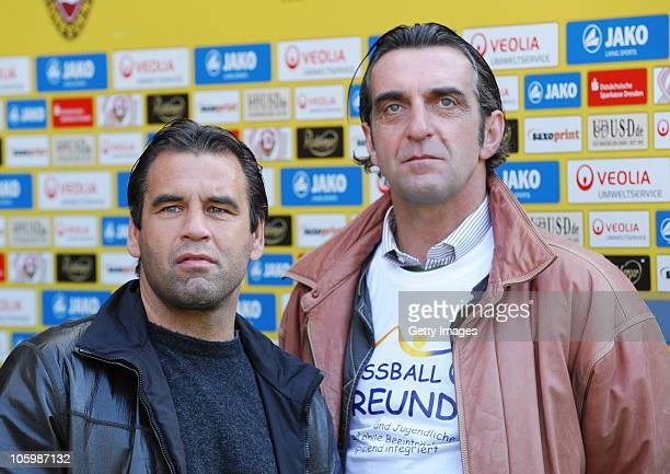 Ulf Kirsten and Ralf Minge during the Third League match between Dynamo Dresden and Hansa Rostock at Rudolf Harbig Stadium on October 23 2010 in...