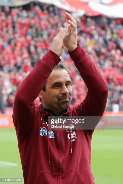 Ulf Kirsten former Bayer 04 Leverkusen player applauds fans as he is presented to the crowd as part of celebrations for 40 years since Bayer 04...