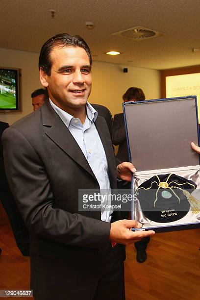Ulf Kirsten holds a cap for 100 matches after being honored byTheo Zwanziger president of the German Football Association honours for 100 matches in...