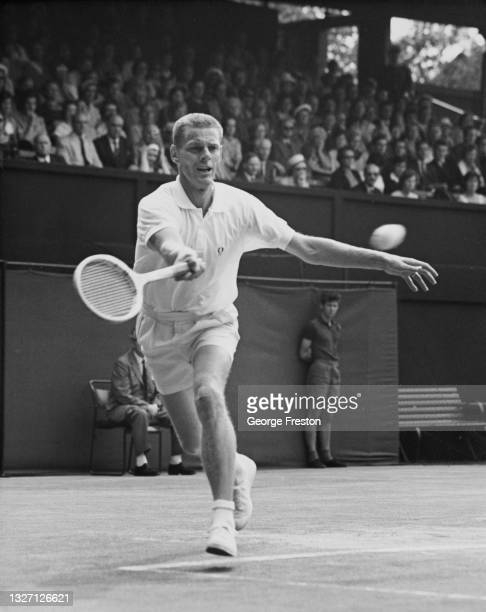 Ulf Schmidt of Sweden reaches to make a running forehand return to Bobby Wilson of Great Britain during their Men's Singles match of the Davis Cup...