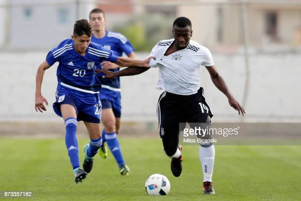 Uli Bapoh of Germany in action against Constantinois Sergiou of Cyprus during the U19 International Friendly between U19 Cyprus and U19 Germany at...