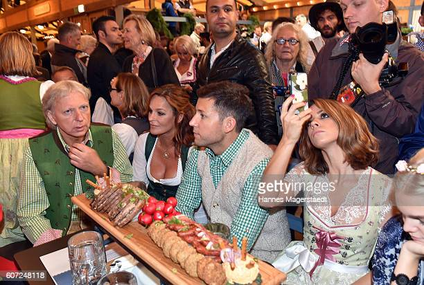 Uli Ferber Andrea Berg Andreas Ferber and Vanessa Mai during the opening of the 2016 Oktoberfest beer festival in the Schottenhamel tent at...