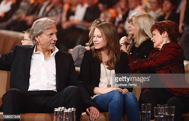 Uli Ferber with daughter Lena Maria and Helga Zellen gesture during the Andrea Berg 'Die 20 Jahre Show' at Baden Arena on December 7 2012 in...