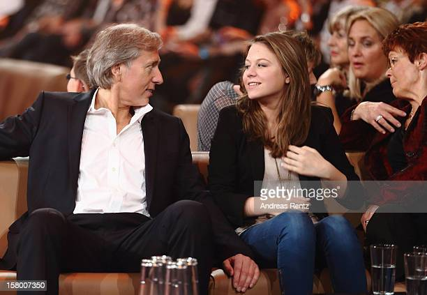 Uli Ferber with daughter Lena Maria and Helga Zellen gesture during the Andrea Berg 'Die 20 Jahre Show' at Baden Arena on December 7, 2012 in...
